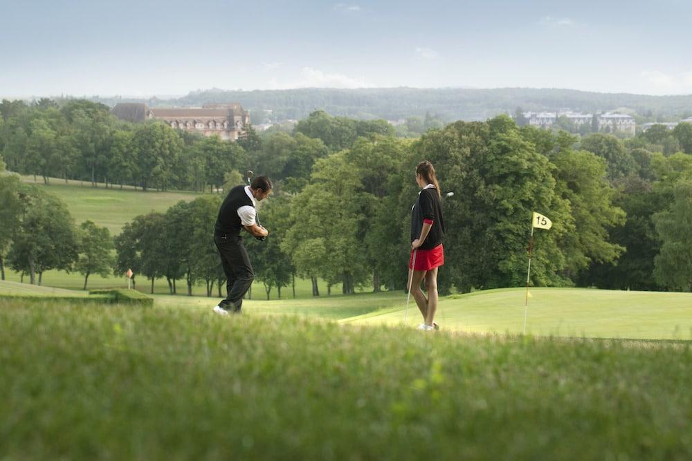 golfeur golfeuse couple swing Golf de Vittel Ermitage