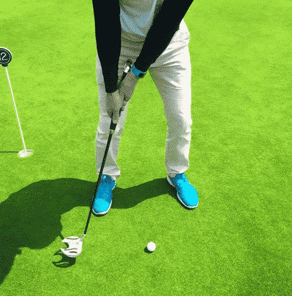 golfeur putting green